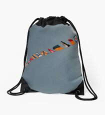Flags fly over the deck of the USS Iwo Jima. Drawstring Bag