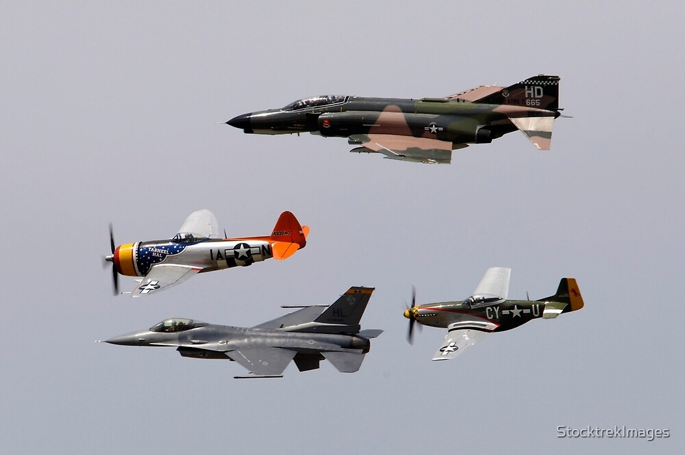 An F-4 Phantom, P-47 Thunderbolt, F-16 Fighting Falcon and P-51 Mustang fly in a heritage flight. by StocktrekImages