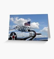 A BT-13 Valiant trainer aircraft with American Flag. Greeting Card