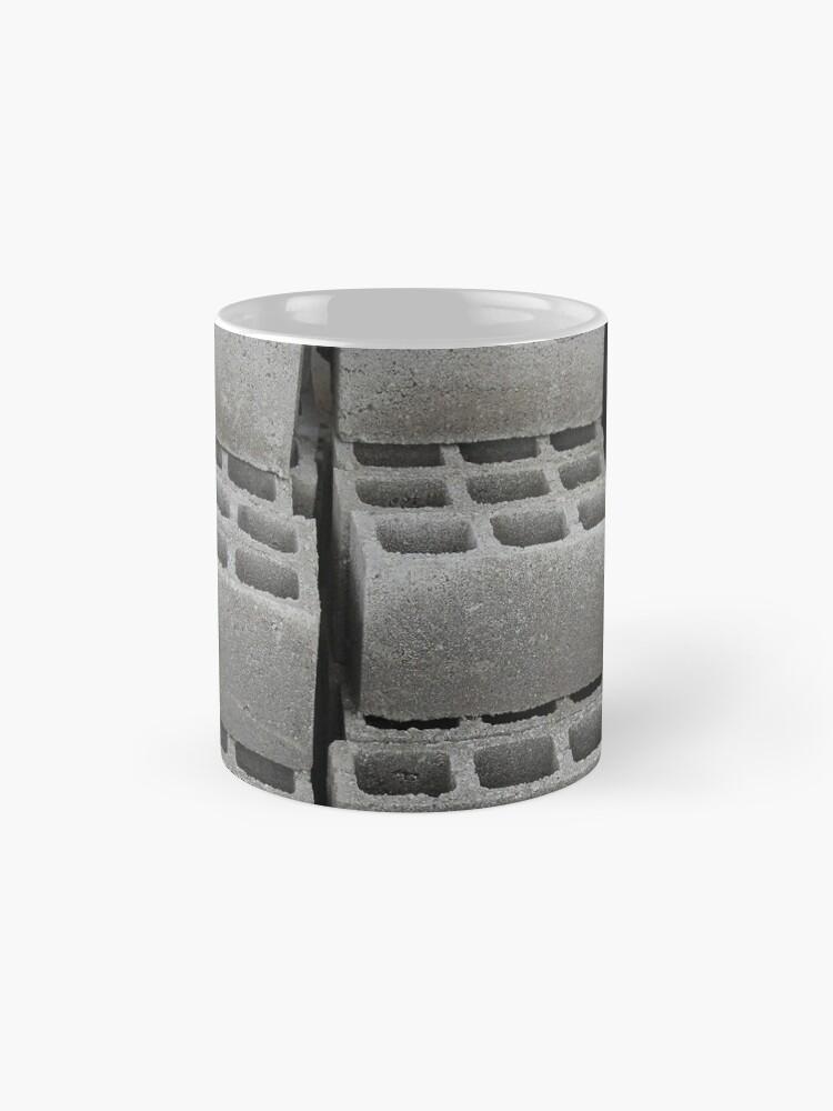 Alternative Ansicht von Betonblöcke auf einer Baustelle Tassen