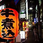 Street-side advertising - Tokyo, Japan by Norman Repacholi
