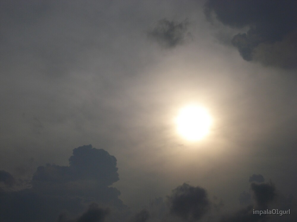 Sun peeking out through a storm by impala01gurl