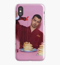 Joe Jonas pouring syrup over some pancakes iPhone Case/Skin
