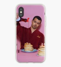 Joe Jonas pouring syrup over some pancakes iPhone Case