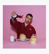 Joe Jonas pouring syrup over some pancakes SQUARE! Photographic Print