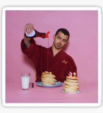 Joe Jonas pouring syrup over some pancakes SQUARE! Sticker