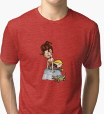 Redhead Pinup in Lingerie Fearing a Toy Alligator on an Ottoman Tri-blend T-Shirt