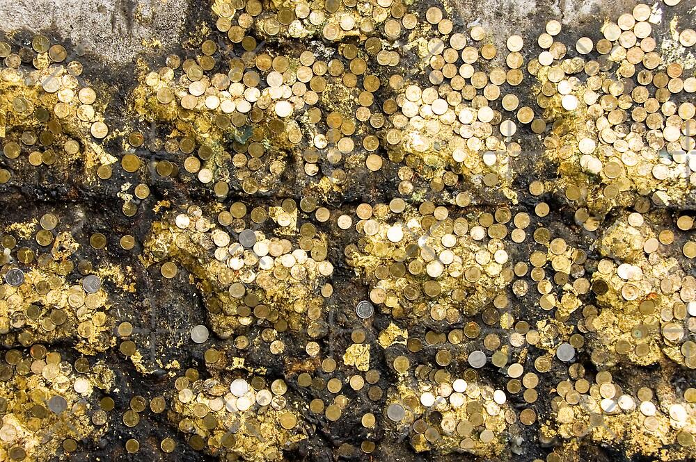 Gold coins by Juha Sompinmäki