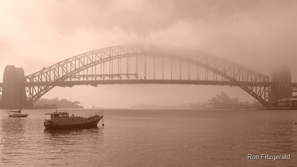 Sydney harbour bridge in Fog. by Ron Fitzgerald