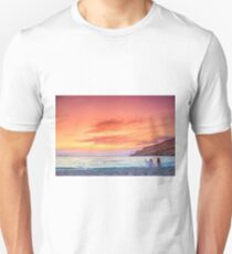 Two women taking photos of the amazing sunset at the beach of Matala, Crete, Greece. T-Shirt