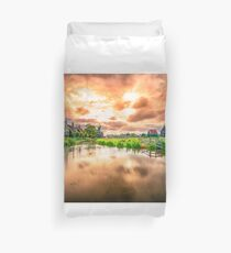Traditional village with dutch windmills and river at sunset, Holland, Netherlands. Duvet Cover