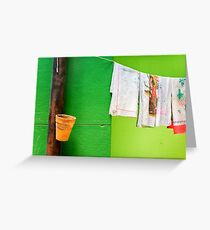 Vase, towels and green wall Greeting Card