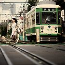 The Lady and The Streetcar: Ikebukuro, Tokyo, Japan by Alfie Goodrich