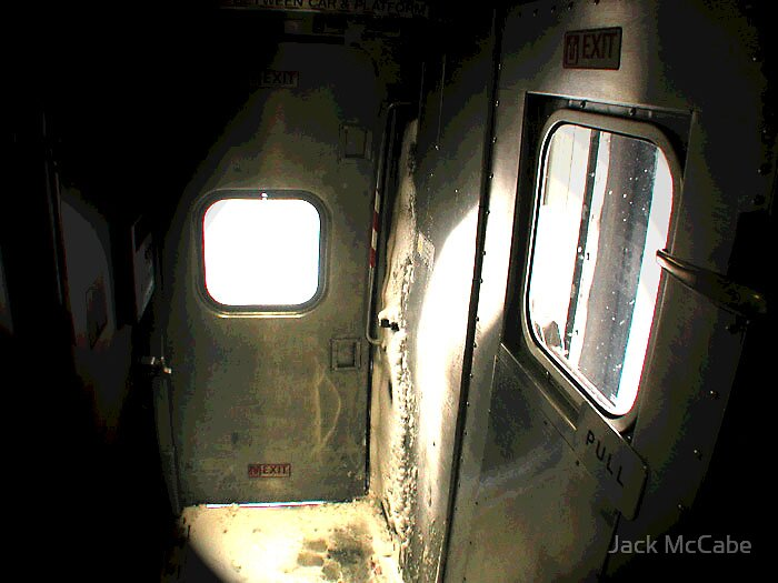 Train from Wilmington Series | Snow in the vestibule by Jack McCabe