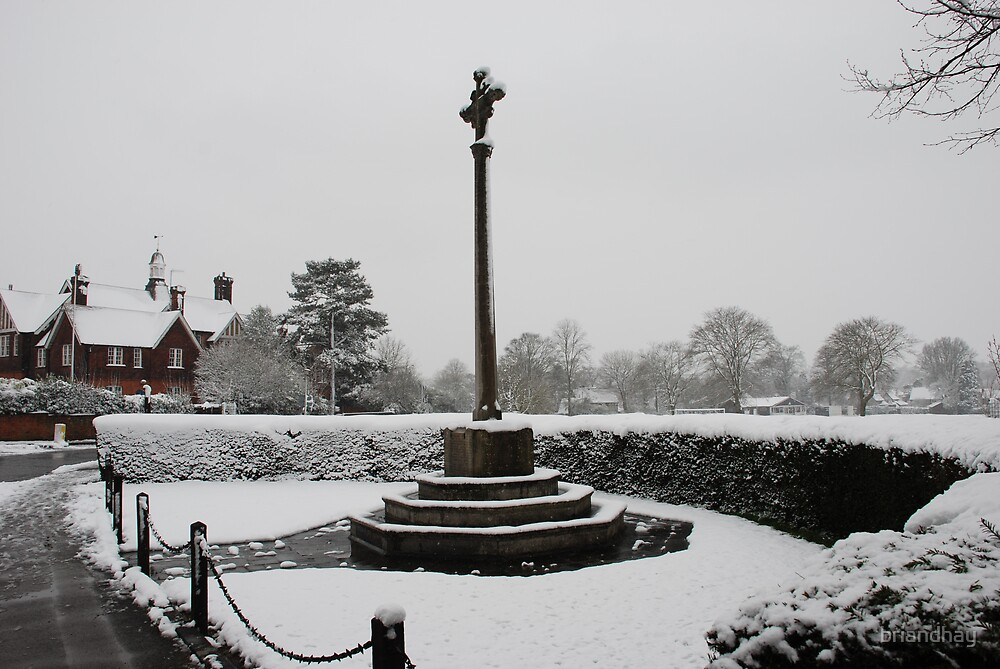 Oxted War memorial in the snow by briandhay