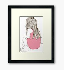 Little girl in a pink dress sitting back hair Framed Print