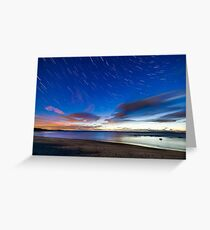 Star trials and cloud in the sky over a white beach Greeting Card