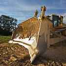 Dirty yellow bulldozer by Mikhail Lavrenov