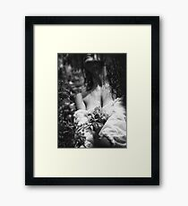 Sensual artistic black and white photo of beautiful woman with pink roses in wet dress under a rain art print Framed Print