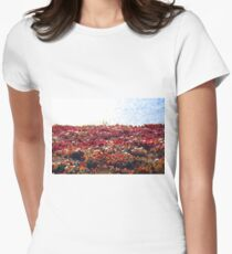 closeup red flower with blue ocean background in summer T-Shirt