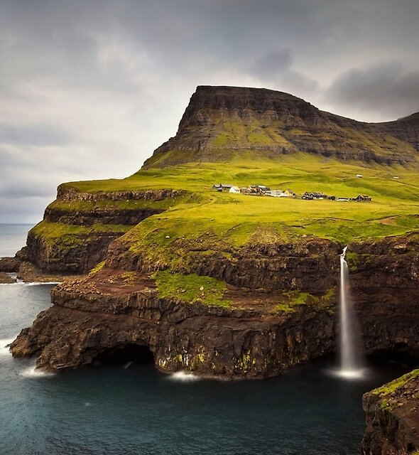 Gasadalur Waterfall and Village by Claire Walsh