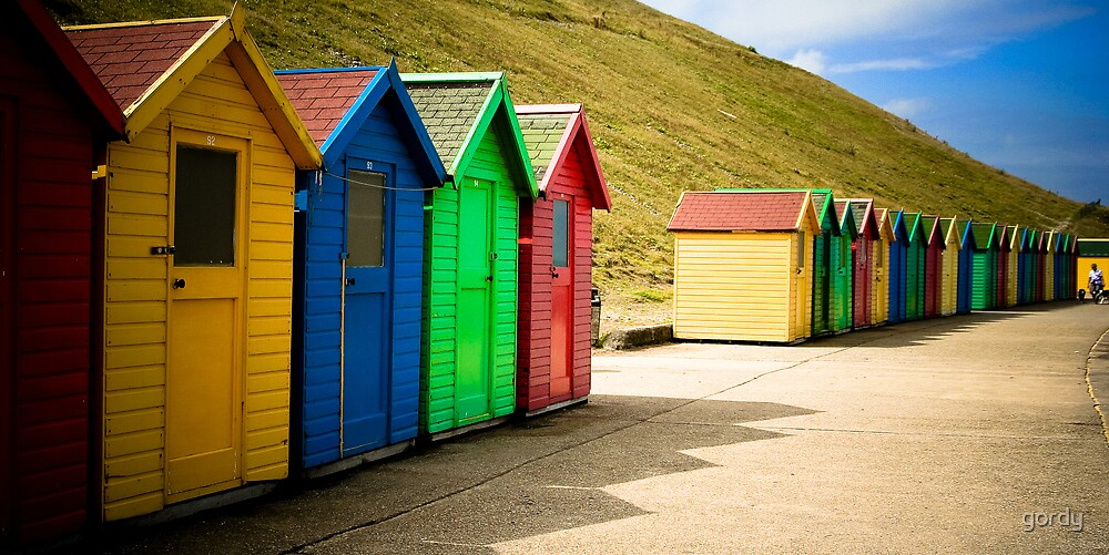 Colourful chalets at Whitby. by gordy