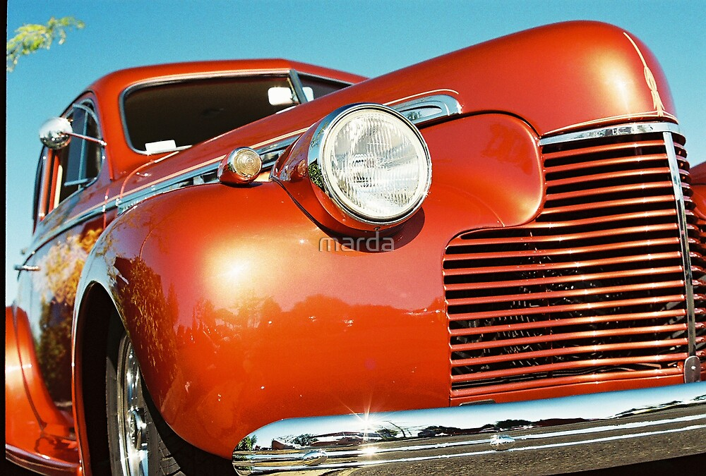 red truck on blue sky by marda
