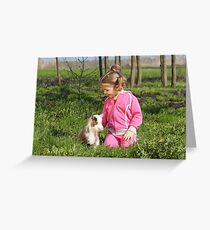 little girl with kid pet Greeting Card