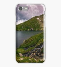 lake in mountains with snow on hillside iPhone Case/Skin