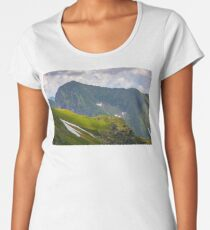 rocky edge on grassy hillside with snow  Women's Premium T-Shirt