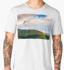 Skydiving  extreme over the mountains Men's Premium T-Shirt