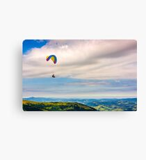 Skydiving  extreme over the mountains Canvas Print