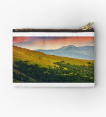 mountain ridge with peak behind the hillside at sunset Studio Pouch