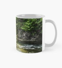 rapid flow of the river in forest Classic Mug