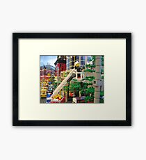 Fireman rescues kitten Framed Print