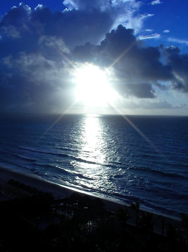 Sunrise in Cancun by Vpeg