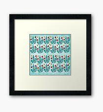 ramas y flores con fondo azul Framed Print
