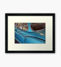 Back side of a blue vintage car  Framed Print