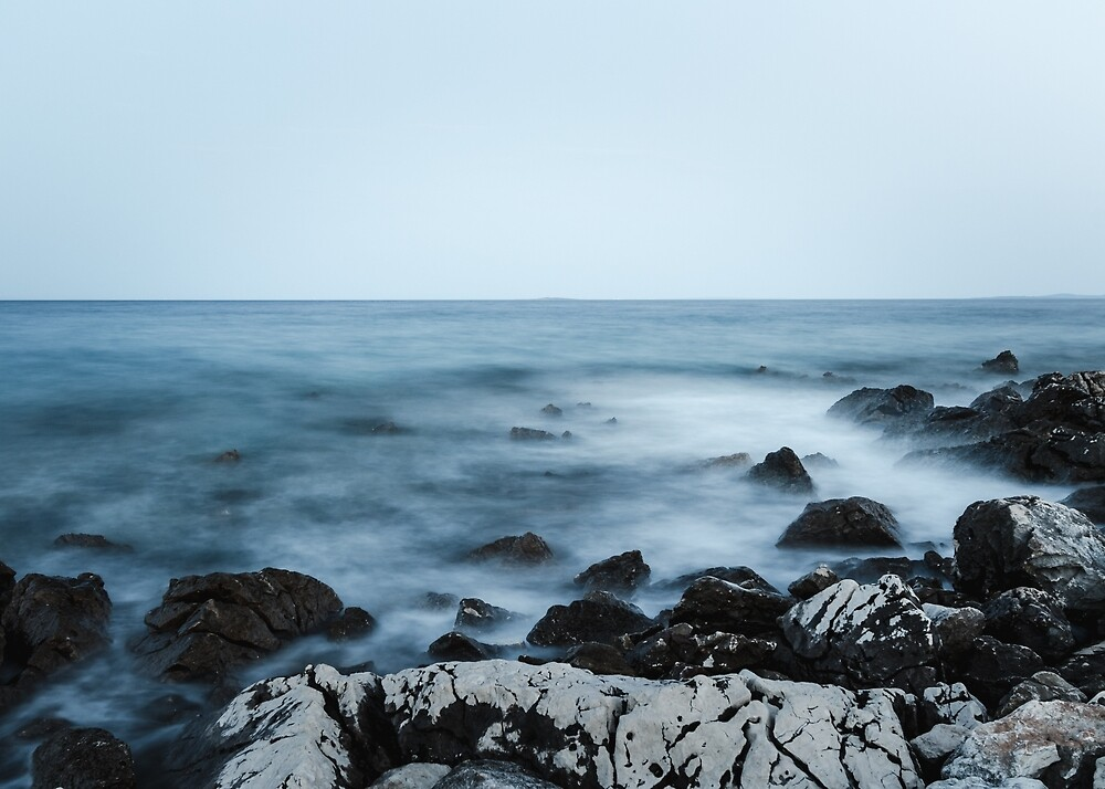 Rocky shore with misty water by Patrik Lovrin