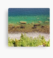 Stone shore on the lake Canvas Print
