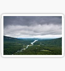 Storm clouds over a river valley Sticker