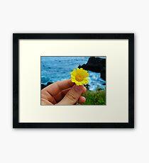 Holding a flower Framed Print