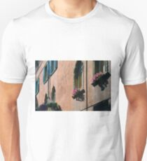 Beautiful Italian building facade with flowers at windows  T-Shirt
