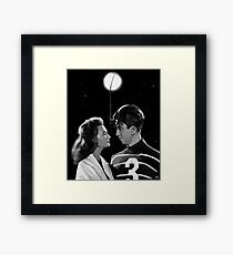 George Lassos the Moon Framed Print