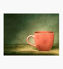 Red cup on old wooden table. Photographic Print