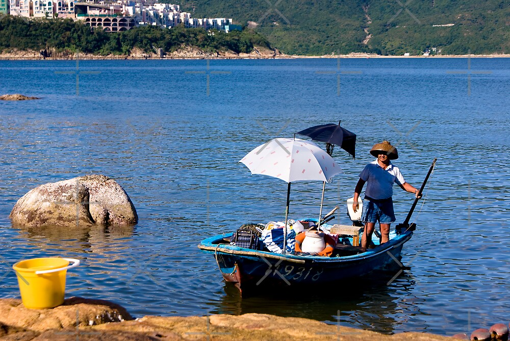 A fisherman in Hong Kong  by Enrico Hernandez