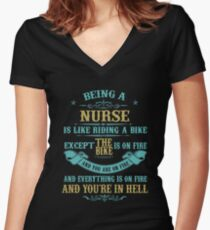 BEING A NURSE IS LIKE RIDING A BIKE EXCEPT THE BIKE IS ON FIRE AND YOU ARE ON FIRE AND EVERYTHING IS ON FIRE AND YOU'RE IN HELL Women's Fitted V-Neck T-Shirt