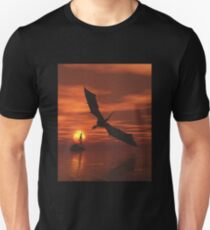 Dragon Flying Low Over the Sea at Sunset T-Shirt