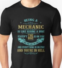 BEING A MECHANIC IS LIKE RIDING A BIKE EXCEPT THE BIKE IS ON FIRE AND YOU ARE ON FIRE AND EVERYTHING IS ON FIRE AND YOU'RE IN HELL T-Shirt