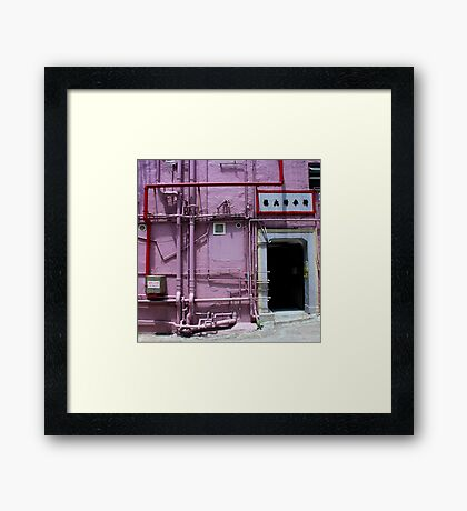 Pipes, wall, door and a bit of pavement. Framed Print